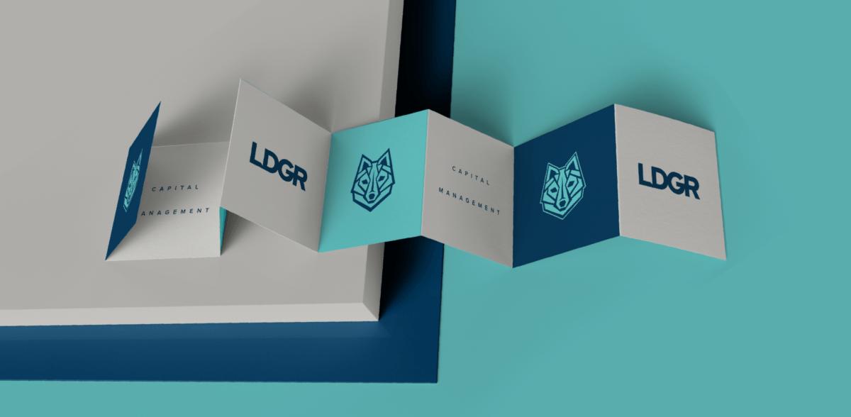 LDGR Capital Management branded folder designed by Ozzmata